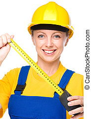 Young construction worker with tape measure - Young happy...