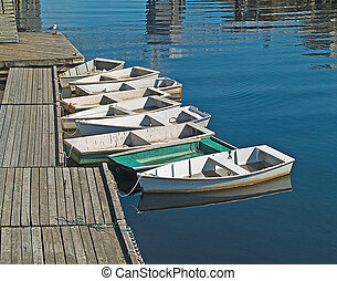 SKIFF ROW - A ROW OF SKIIFS AT THE DOCK