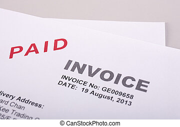 Paid Invoice - Invoice with paid stamp close up