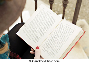 Romantic girl reading a book - A romantic girl in a vintage...