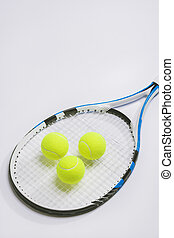 Tennis racket and three green balls on white background.