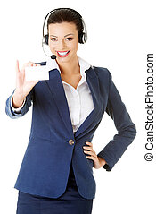 Smiling customer service representative with headset holding...