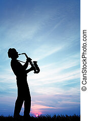 saxophonist at sunset - illustration of a saxophonist at...