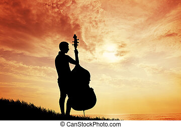 Musicist at sunset - illustration of a violoncellist t at...