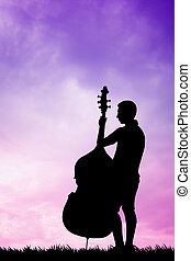 Musicist at sunset - illustration of a violoncellist at...