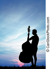 Musicist at sunset - illustration of a cellist at sunset