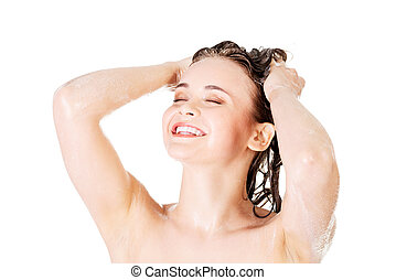 Young fit woman in shower washing her body