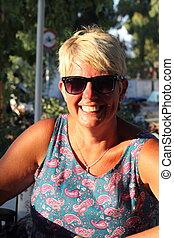 A woman wearing sunglasses