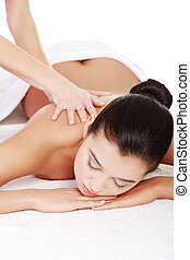 Preaty young woman relaxing heaving massage therapy in spa...