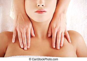 Young relaxed woman enjoy receiving massage - Beautiful...