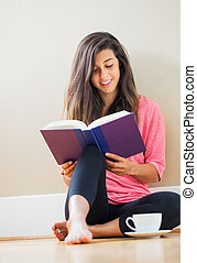 happy young woman reading a book - Portrait of beautiful...