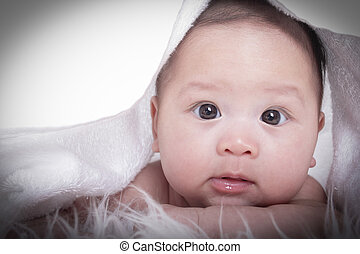 Asian baby girl - Close up Asian baby girl with white...