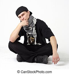 Breakdancer sitting against isolated white background