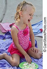 laughing female toddler eating