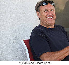 laughing male baby boomer - happy, laughing male baby boomer...