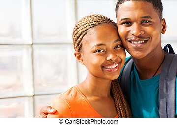 african american university couple - cheerful africam...