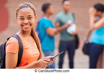 afro american college girl with tablet computer - pretty...