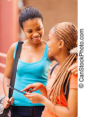 african college students using tablet computer - happy...