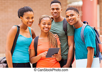 group afro american university students with tablet computer