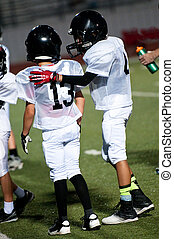 Young american football teammates - Young football boy...