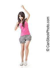 Young asian woman pulls an imaginary rope. Isolated on the...