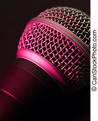Vocal microphone in pink light