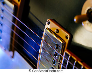 Electric guitar strings and pickups - Macro abstract photo...