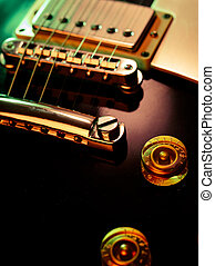 Electric guitar pickup and bridge - Macro abstract photo of...