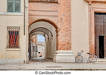 archway in Comacchio, Italy - narrow alley with archway in...