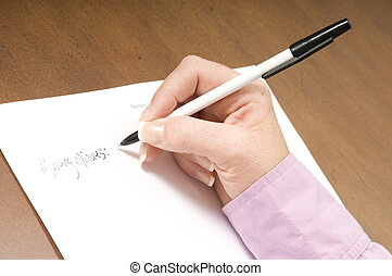 Writing a list - ladies hand writing up meeting minutes at...