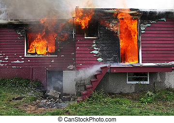 Abandoned House in flame - Abandoned house in fire with...