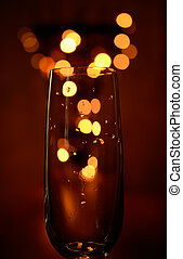 Sparkling wine with blurred lights
