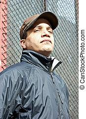 coach in cap - african american male dressed as a coach...