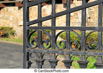 Wide open wrought iron gate - Wide open black wrought iron...