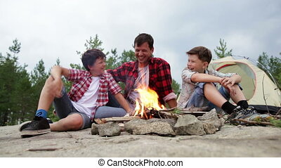 Cheerful flames - Cheerful dad and his kids having a good...