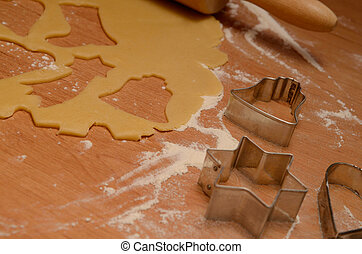 Christmas bakery background with baking tin, cut out some...