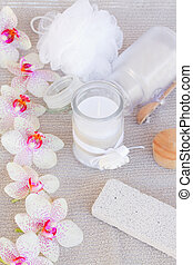 spa accessories with pink orchideas