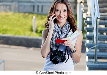 young woman tourist making phone call