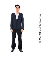 Full body of a smiling young Asian executive standing...