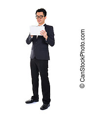 asian chinese business man with a tablet