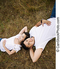 Happy asian couple - A happy asian couple lying down on the...