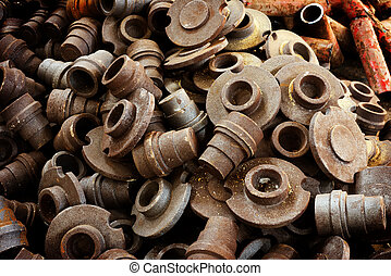 Old parts - stack of rusted metallic car parts in garage
