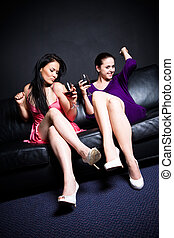 Beautiful women drinking - Two beautiful women drinking and...