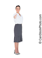 Elegant businesswoman posing thumb up on white background