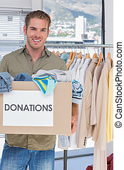 Volunteer holding donation box - Handsome volunteer holding...