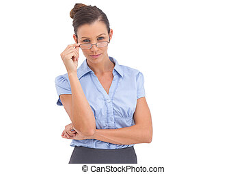 Businesswoman adjusting her glasses on a white background