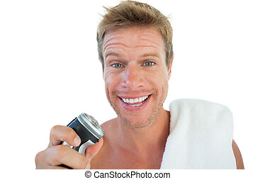 Handsome man holding an electric razor