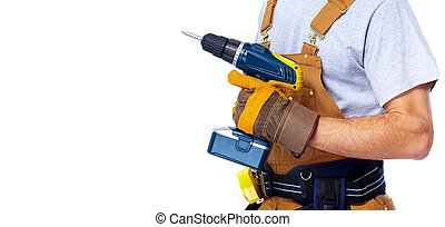Handyman with a drill. House renovation service.