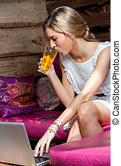 Girl with laptop drinking tea - Portrait of girl drinking...