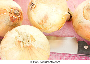 Four onions waiting to be cutted